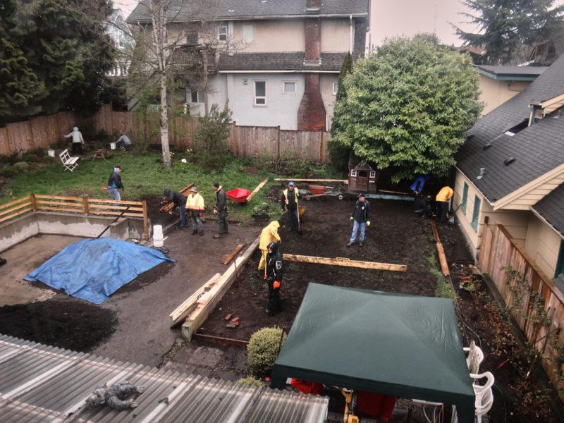 Photo of local outreach team helping in a garden