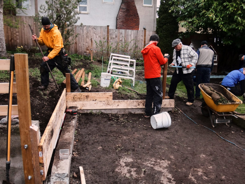 Photo of local outreach team working in a garden