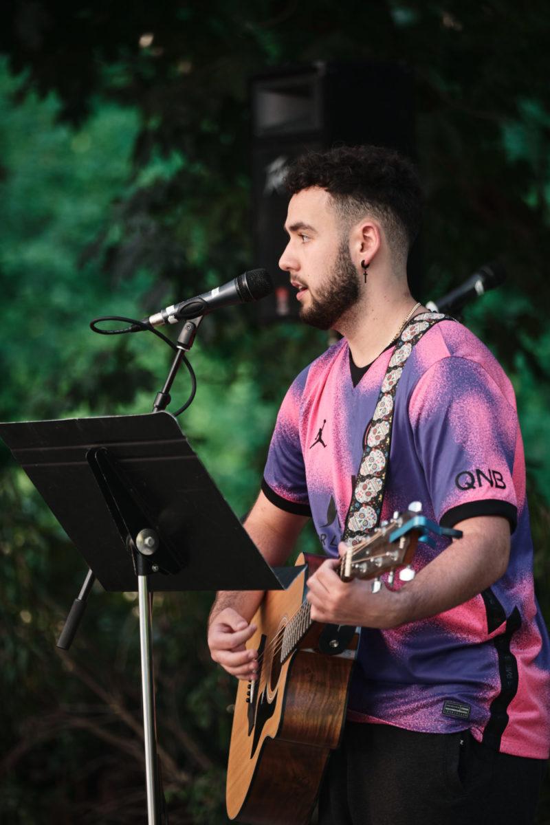 Photo of student leading worship