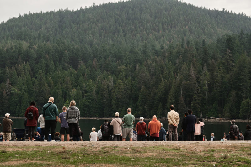 Photo of people gathered at outdoor baptism