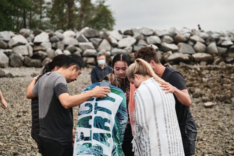 Photo of young adults praying after baptism
