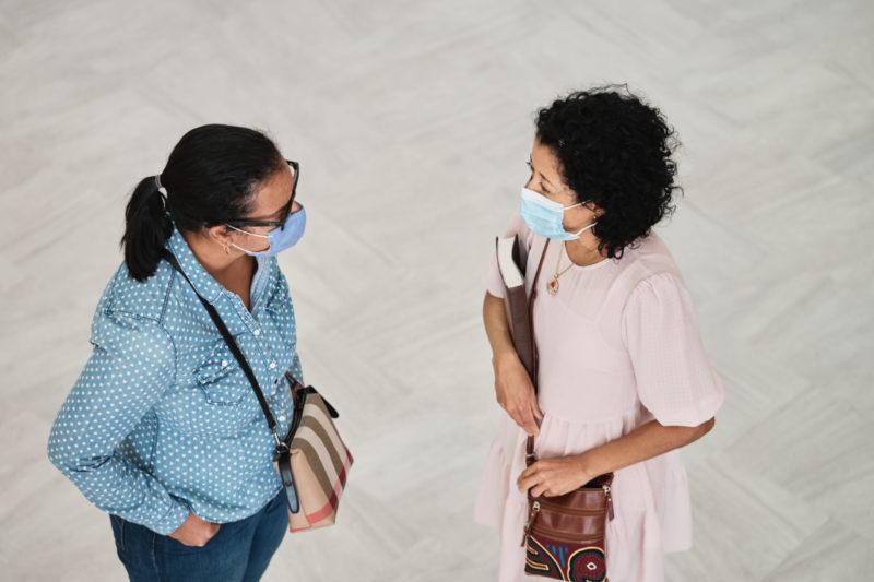 Photo of two women talking