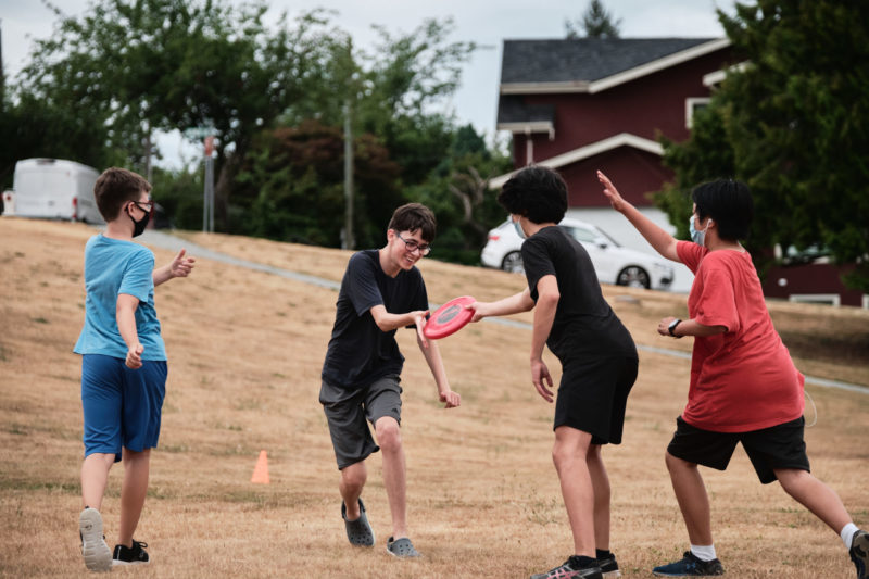 Photo of students playing frisbee