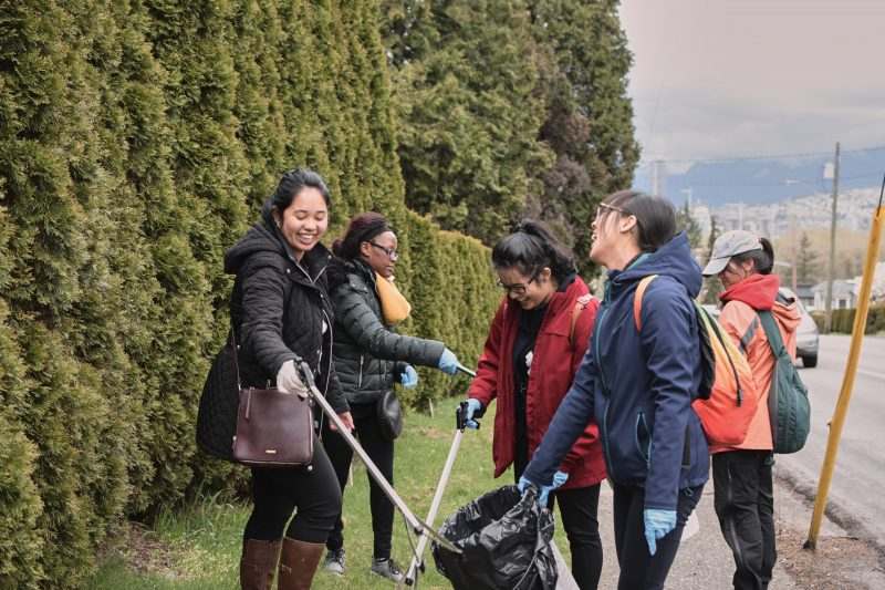 Photo of local outreach team picking up garbage
